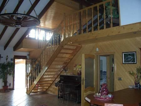 Stairs to Mezzanine, breakfast bar and door to terrace.