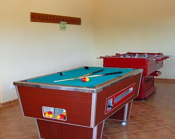 There's a game room with billiards, table tennis and table footbal