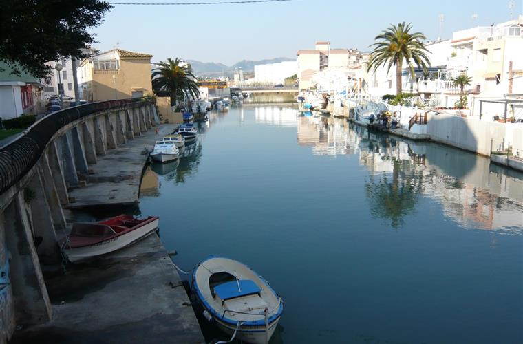 The waterways of Gandia beach town with many markets & attractions
