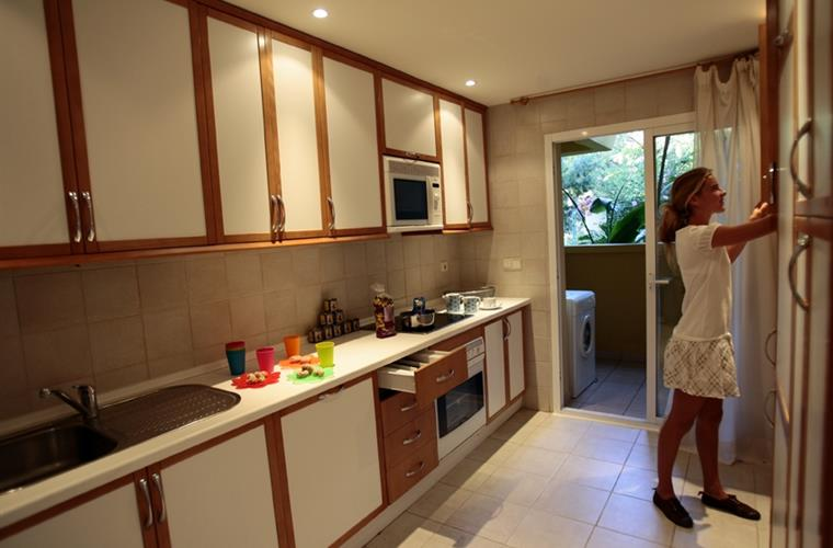 Kitchen with all electrical appliances and garden view