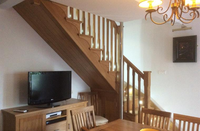 Dining room with stairs to bedrooms