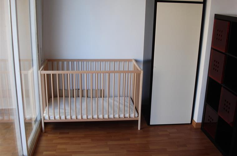 baby's cot in one of the bedrooms