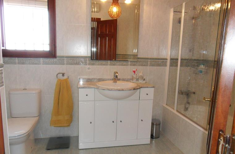 Bathroom with bath, shower, toilet and washbasin furniture