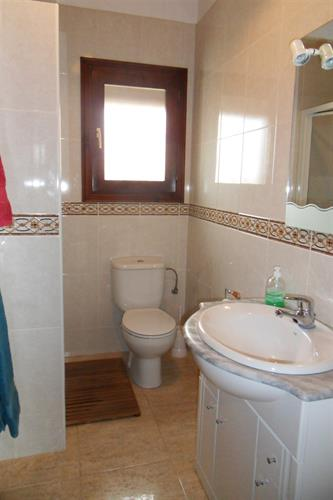 Bathroom with shower, toilet and washbasin furniture