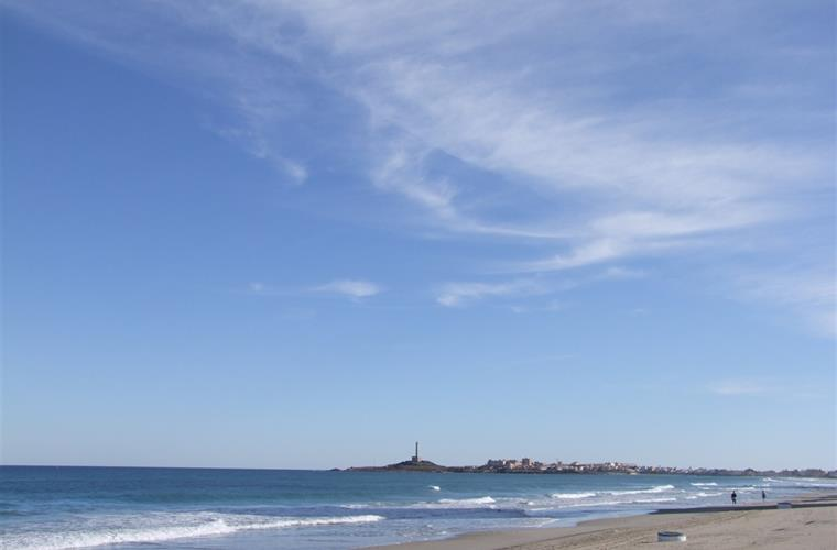 The wonderful beach looking towards Cabo de Palos lighthouse