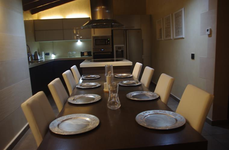 The dining area showing part of the kitchen.