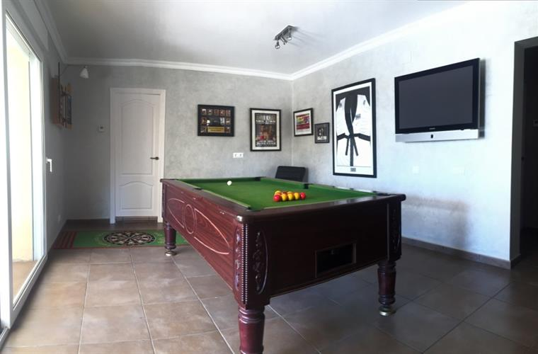 A space downstairs to play pool.