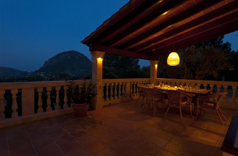 Terrace dining area at night