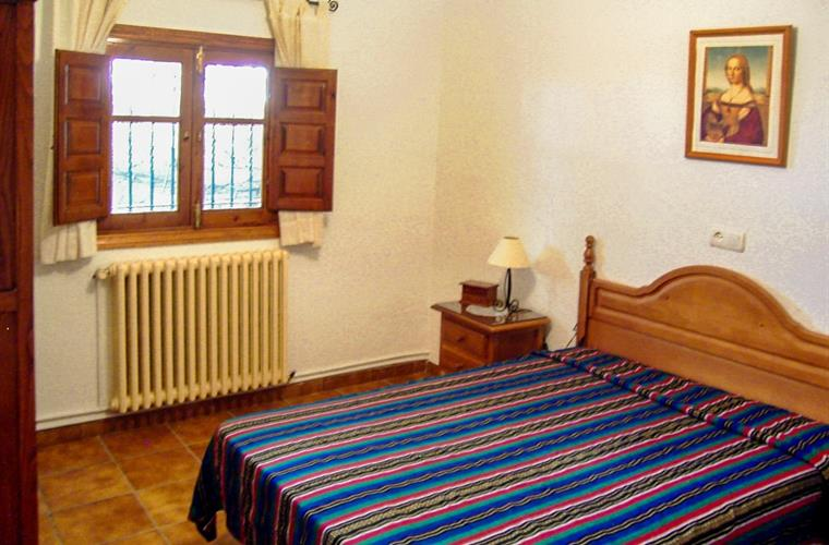 Bedroom with double bed and central heating