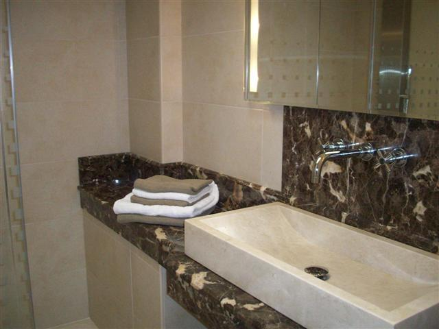 en-suite bathroom with marble sink