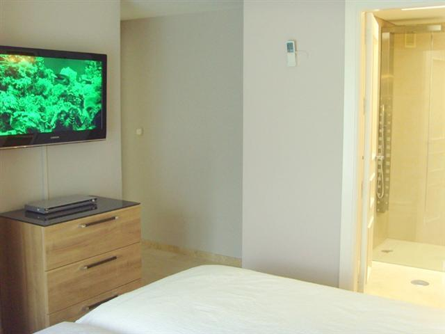 "bedroom 1 with 37""TV and DVD player"