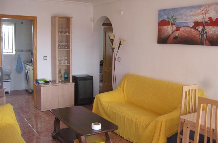 Lounge with settee, sofa-bed, dining table, TV, CD player, air-con