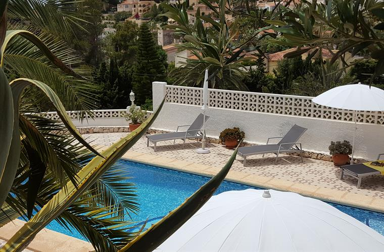 Loungers and parasols on the pool terrace