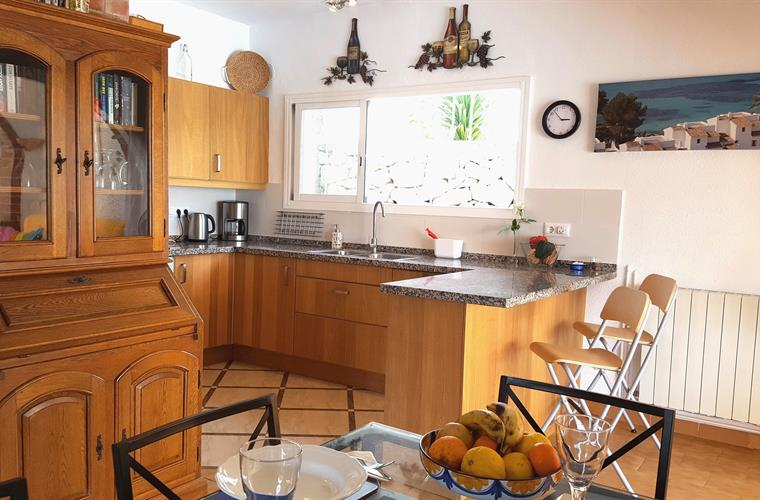 The fully equipped refitted kitchen opens into the dining room
