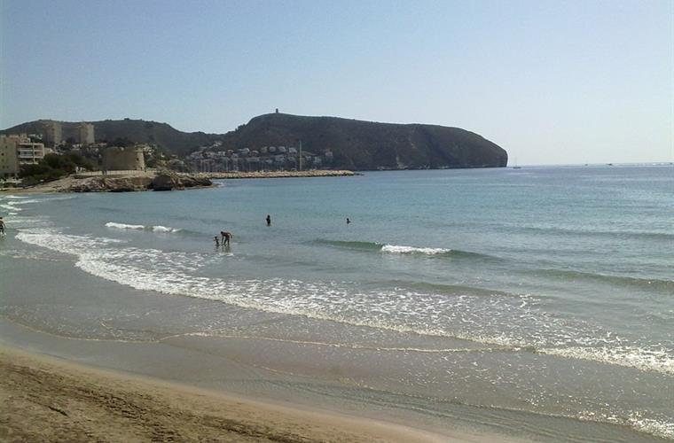 Sand Beach Moraira and clear Water.