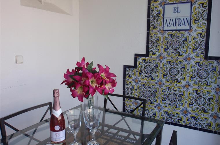 Porch, extra dining area with andalucian tiled wall