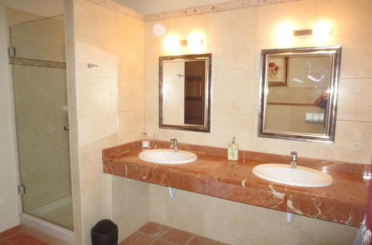 Upstairs ensuite bathroom with double vanity unit