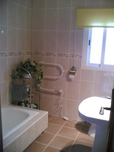 Bathroom with over bath shower