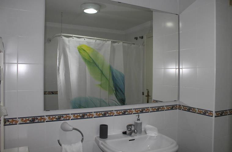 Bathroom with white towels.