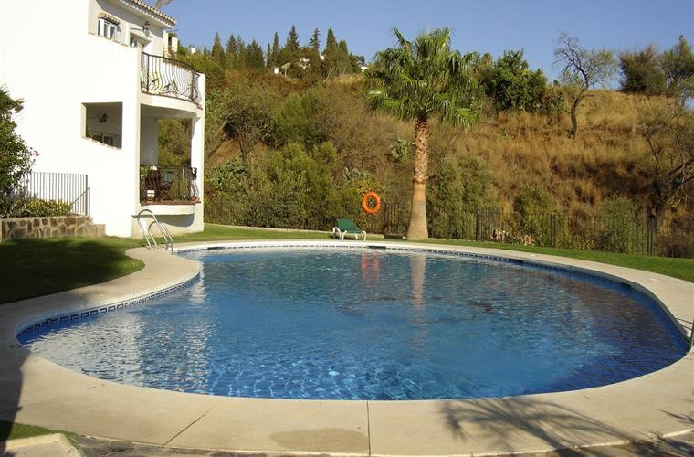 swimming pool set in landscaped gardens