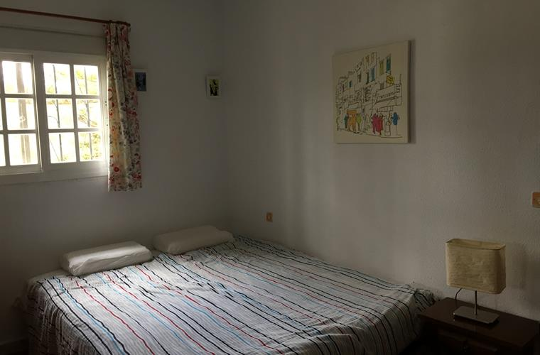 Bedroom with large double bed upstairs