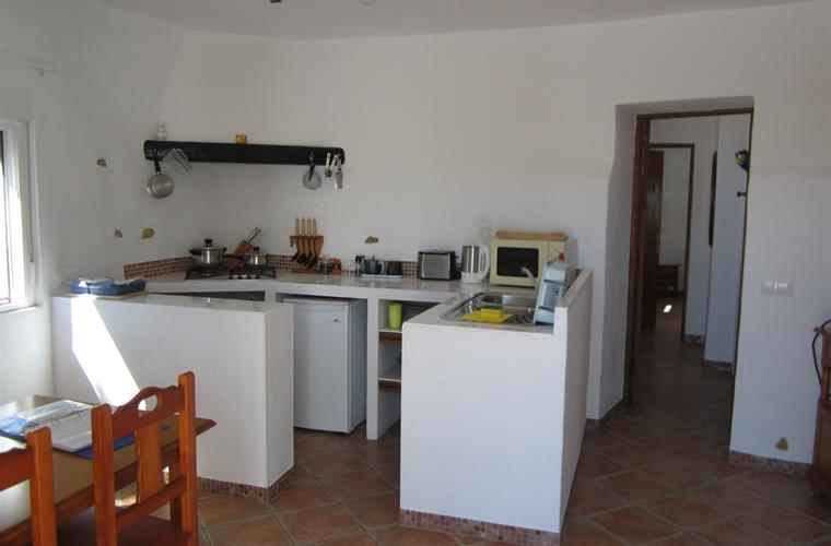 The galley kitchen of El Almendro and the hallway to the bedroom