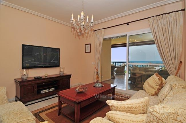 Living room with sliding doors to the terrace and sea view
