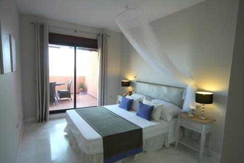 large master bedroom with patio doors  to terrace