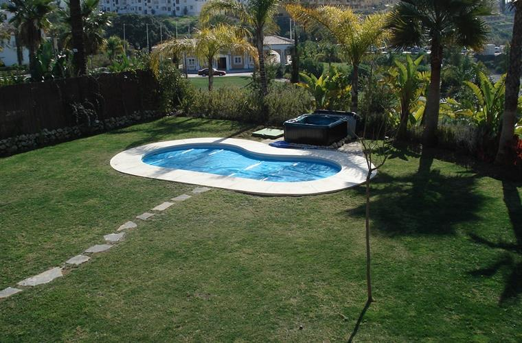 Large private garden with heated pool and hot tub