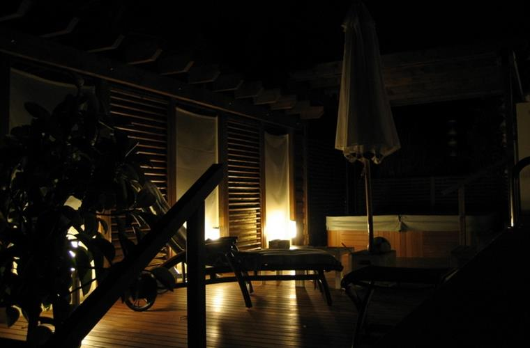 Terrace with jacuzzi by night