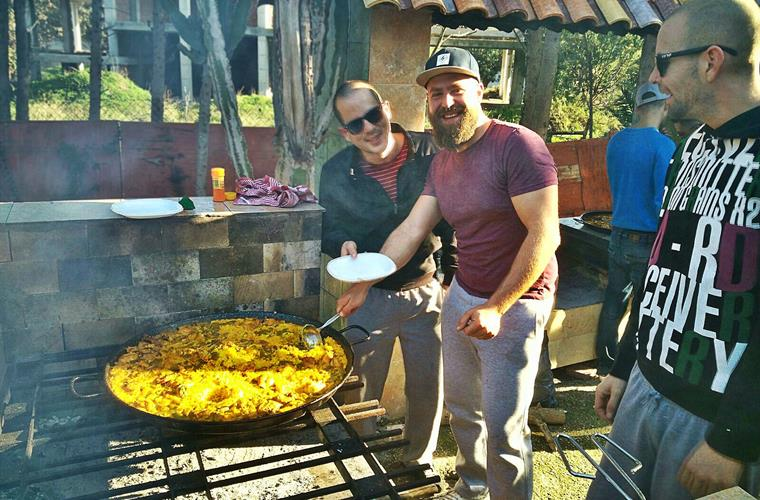 Group of guests make Spanish Paella in winter