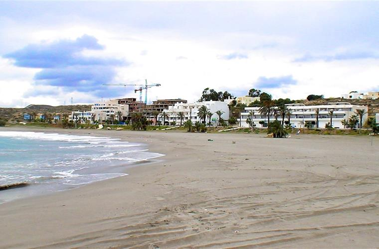 View of beach and apartment complex