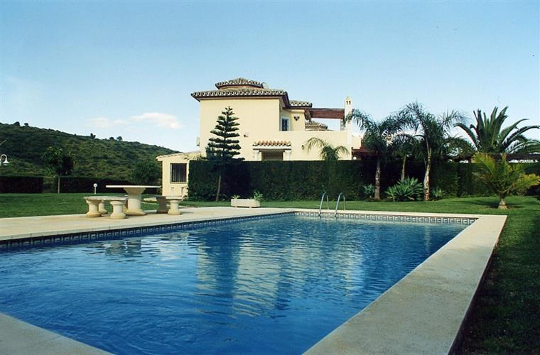 Pool with villa in background