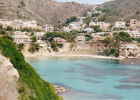 The stunning El Portet beach, enjoy a paella by the sea.