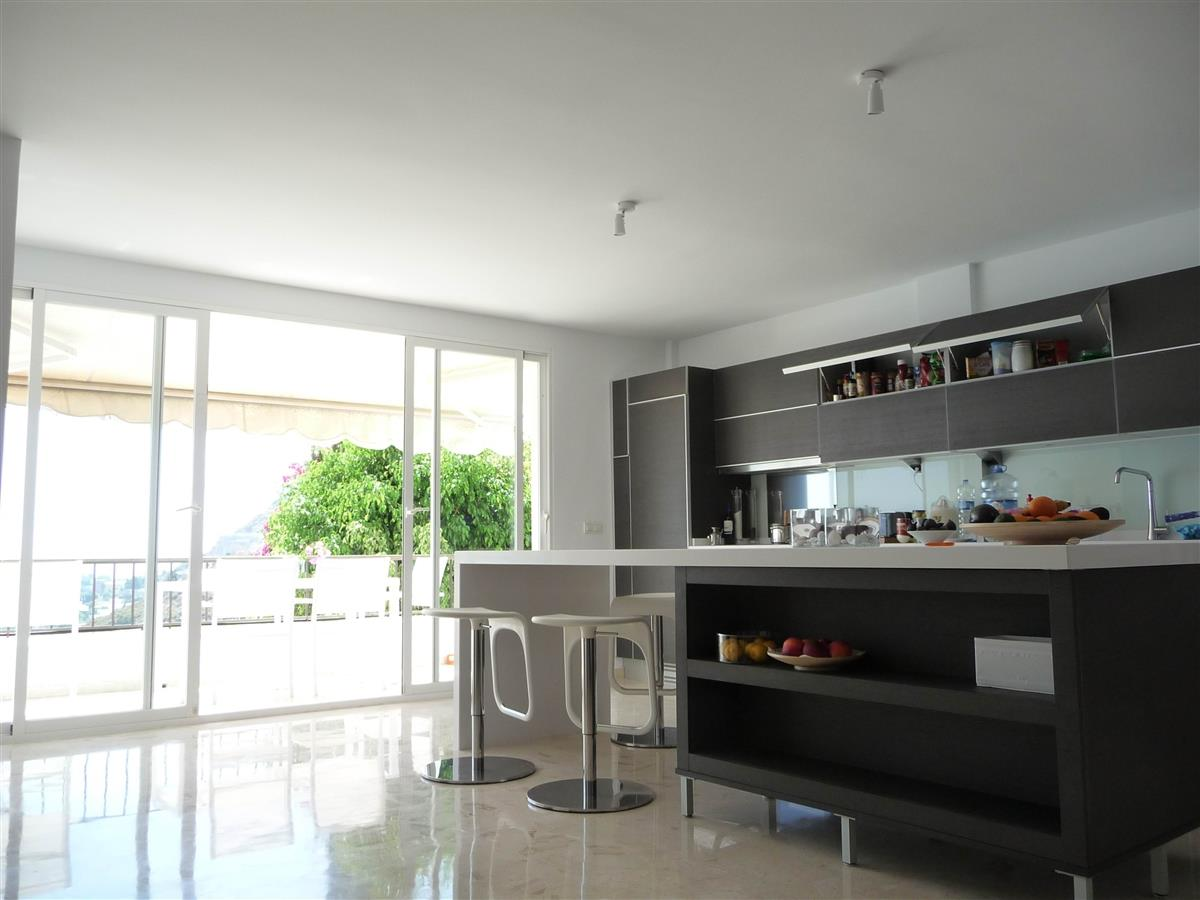 kitchen and view to balcony/sea