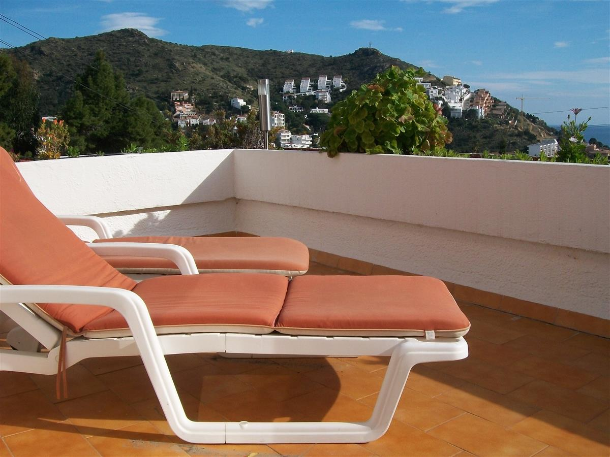 Sunbathing terrace overlooking the sea and mountains.