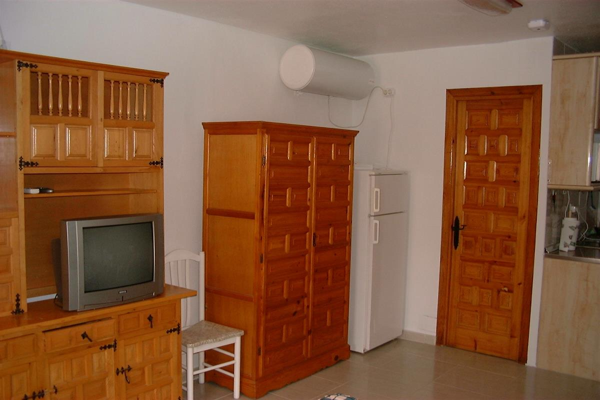 Wardrobe, refrigerator and entrance to shower room