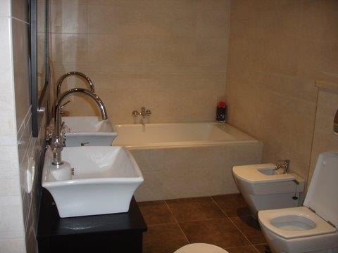 A other bathroom. With a shower, bath, bidet and a toilet.