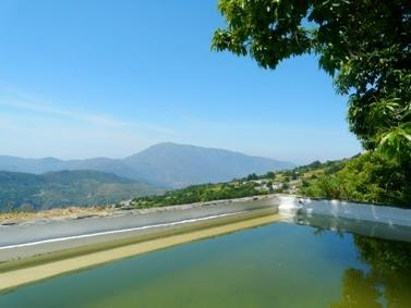 Rustic pool/reservoir 70m above the house and view of the valley