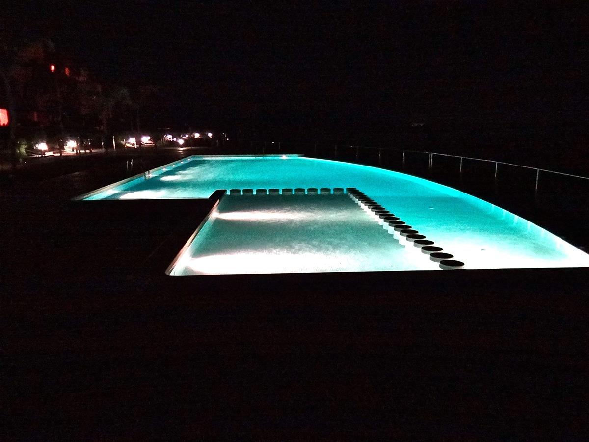 The pool at night time.