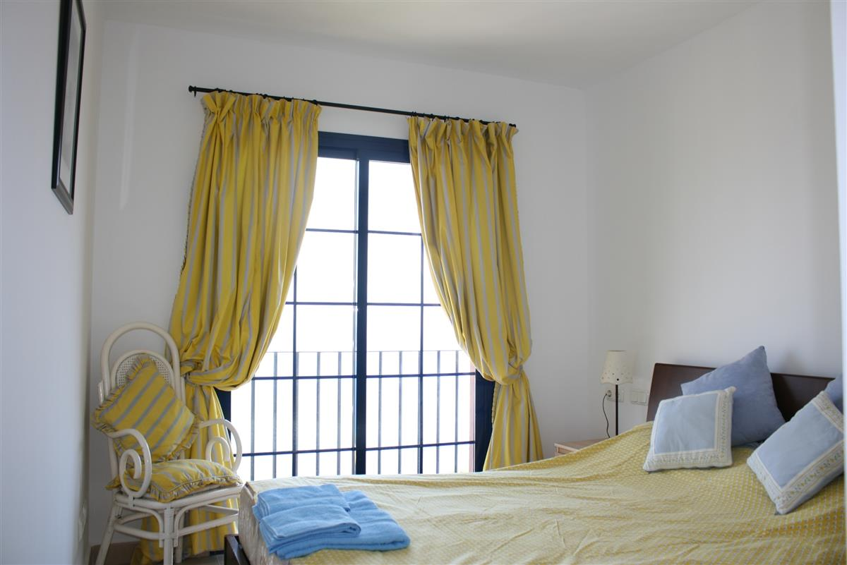 master bedroom with double bed and views over the bay.