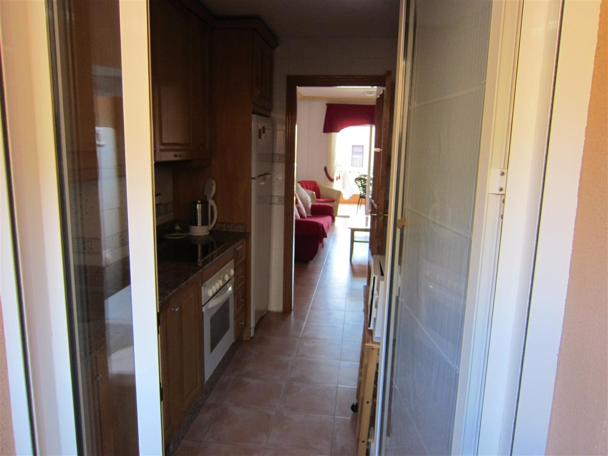 View of the kitchen and lounge from the utility room.