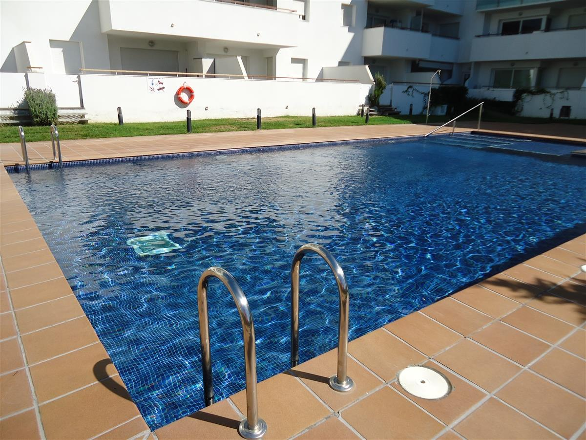 Large communal pool and sunbathing area.