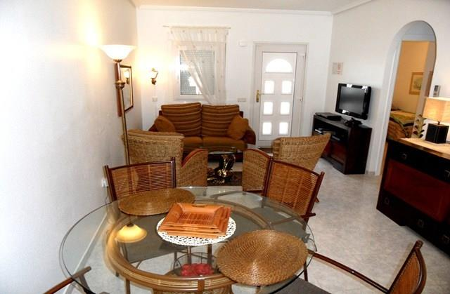 rojales mature singles 2 bedroom apartment for sale in valencia,  with a gorgeous communal pool and mature shrub beds  one with a double bed and the other with two singles.
