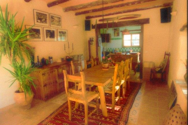 The rustic dinning room leading into the kitchen
