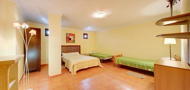 The 5th bedroom holds a double bed plus up to 3 singles or cots