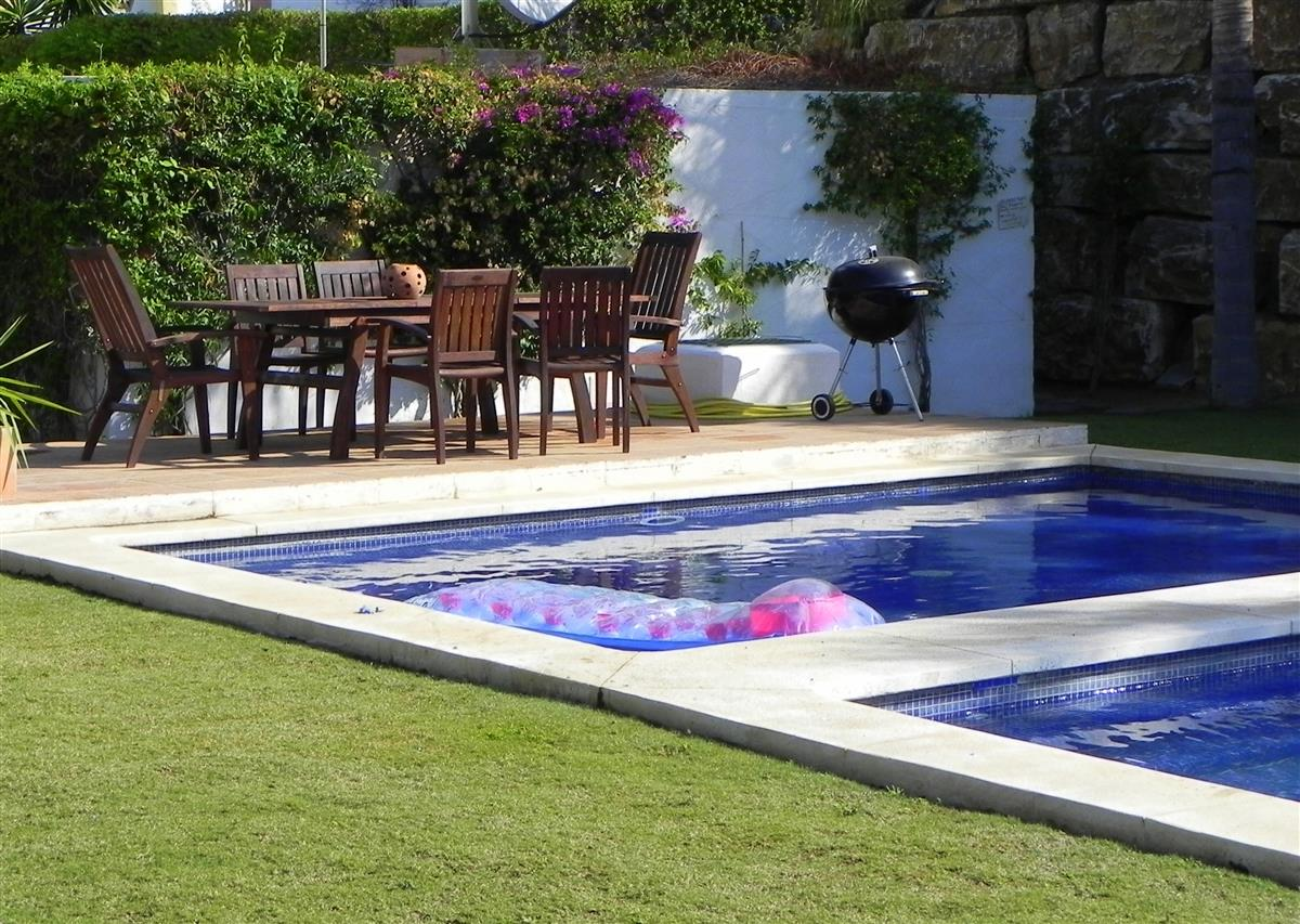 The pool has dining table & and BBQ for guests use