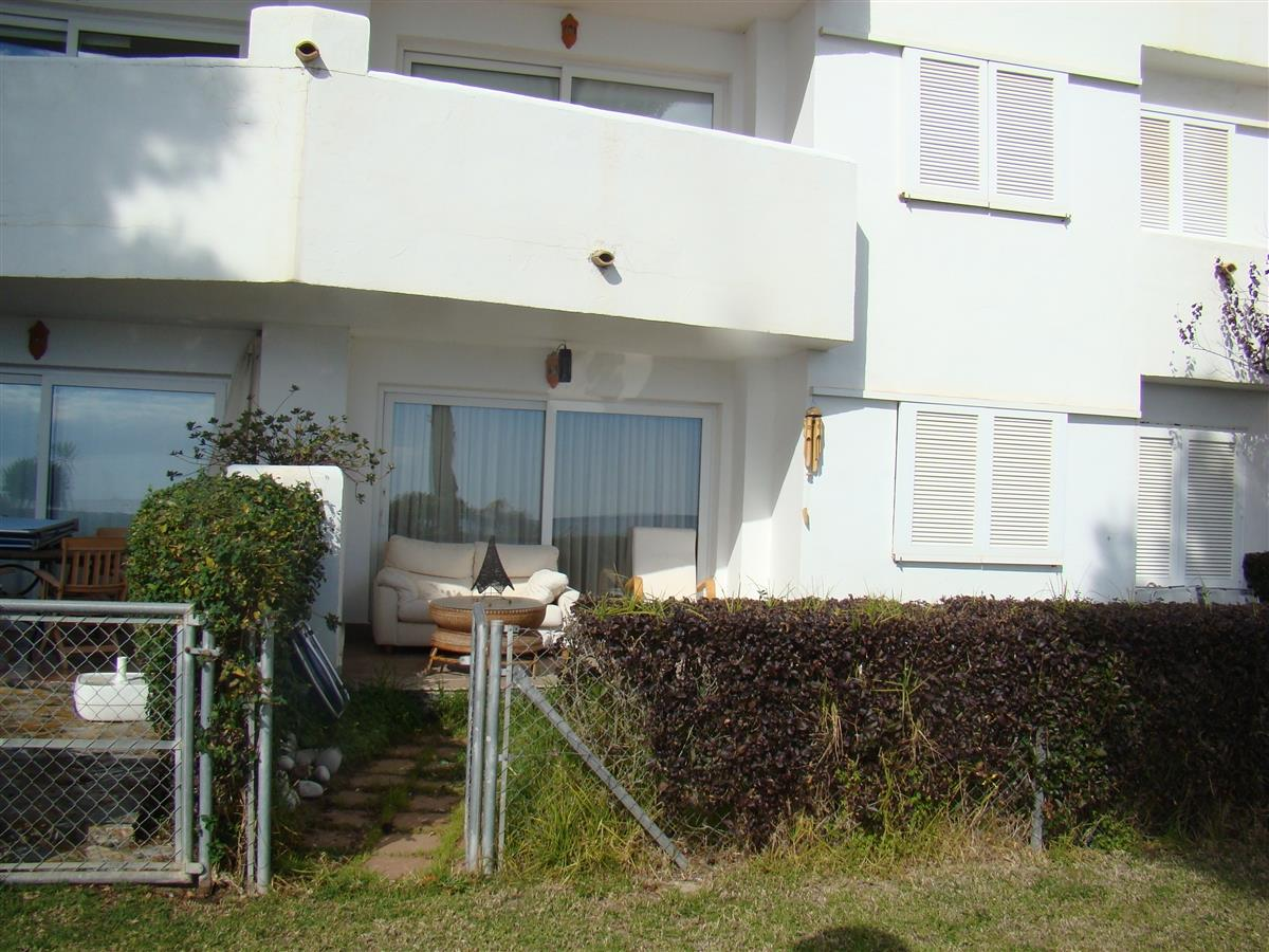 Frontal terrace and door of access to the area of swimming pool, garden and  access to the beach.