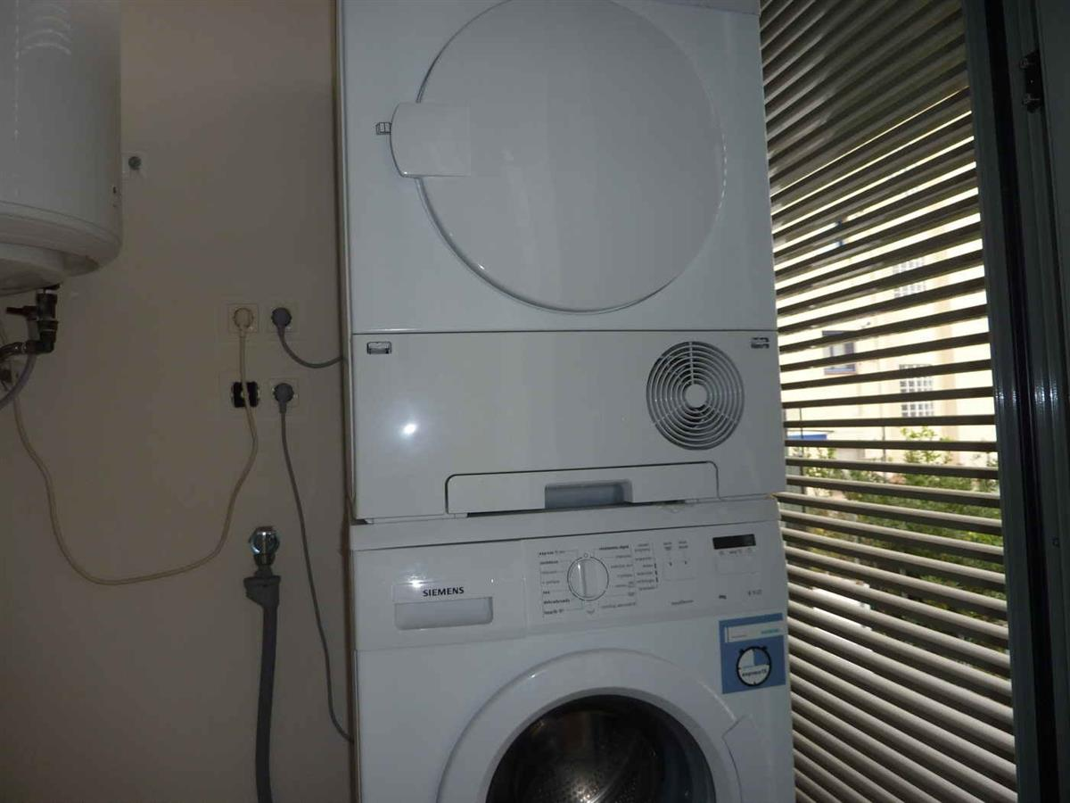 Utility room with washing machine & tumble drier