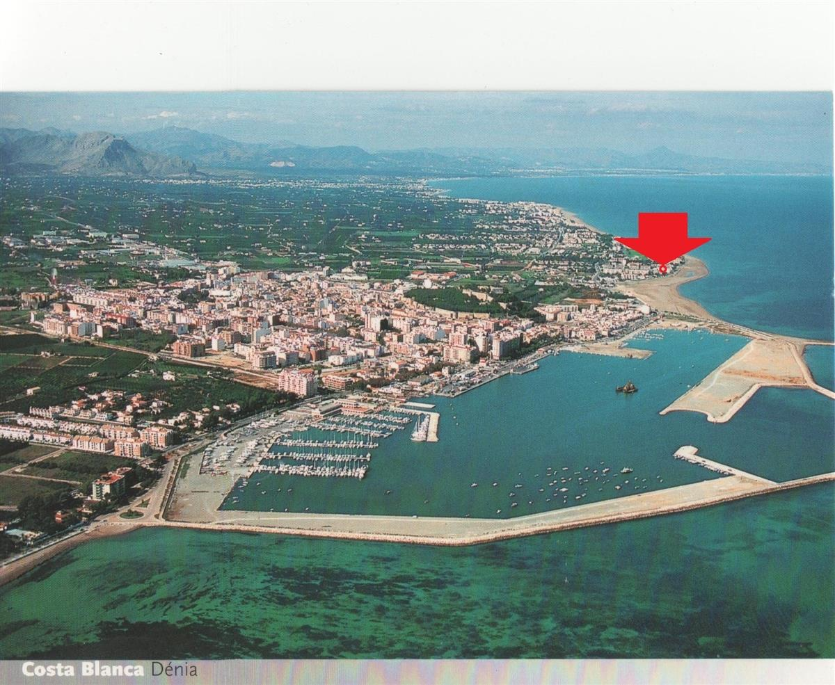 Denia town/port. We are 500m north of the north pier, on the sand